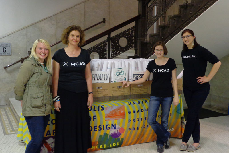 MCAD staff with the prints at City Hall