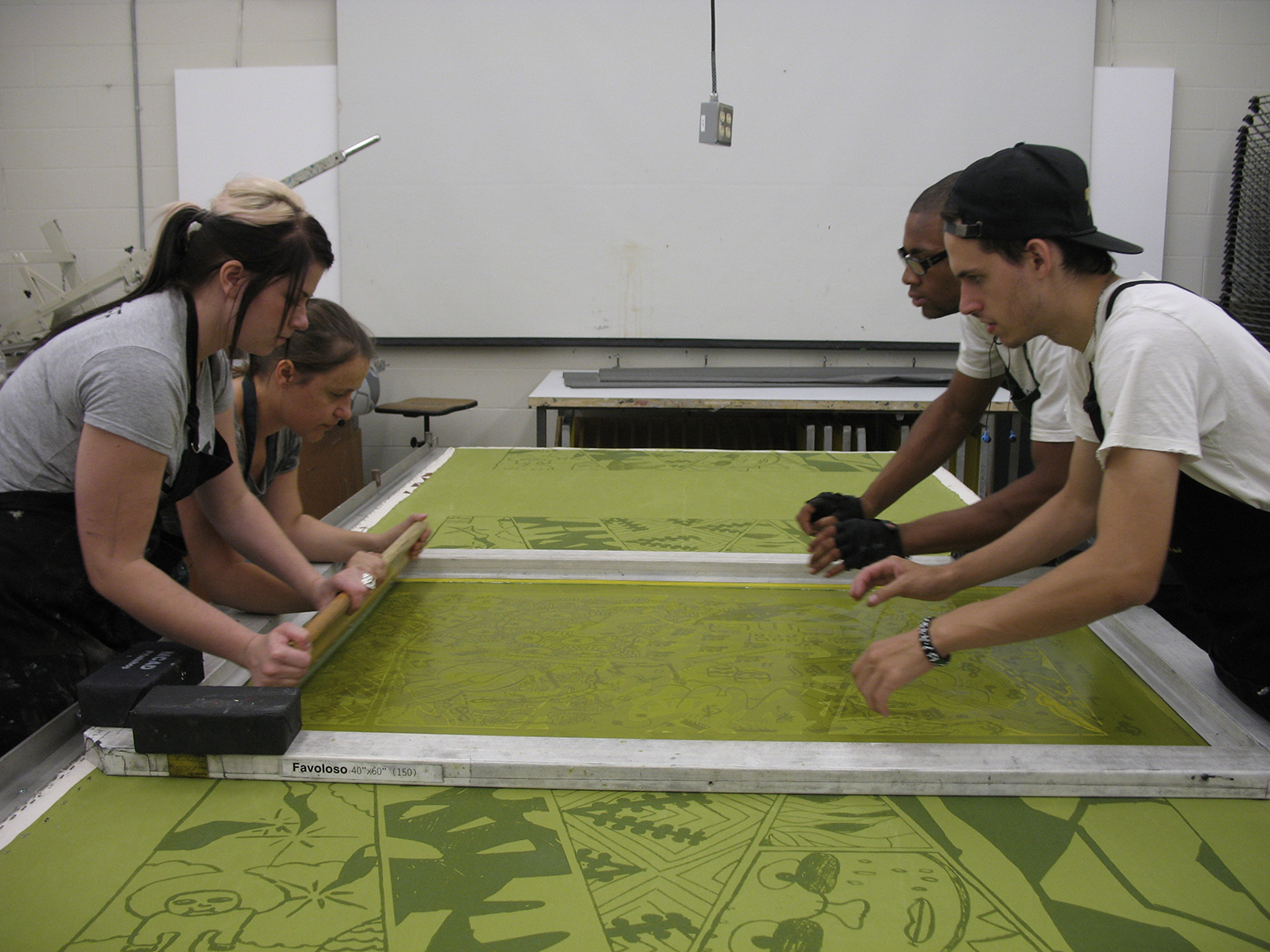 Screenprinting custom couch slipcovers in the MCAD printshop